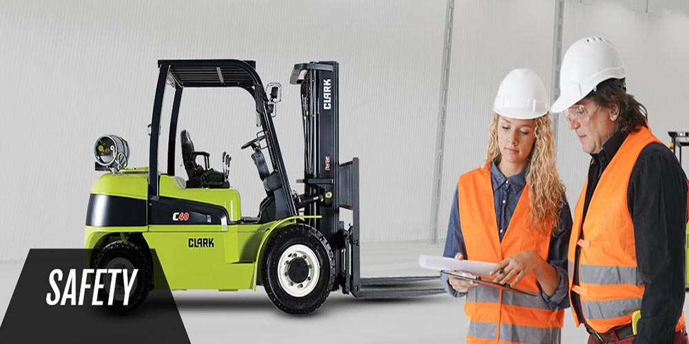 forklifts and two women